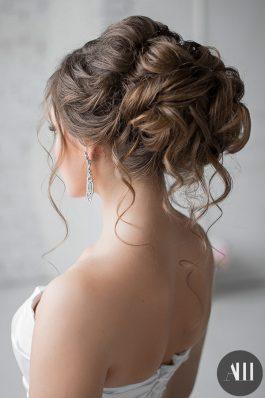Свадебная прическа пучок с накладными прядями